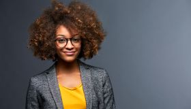 Portrait of confident professional with curly hair