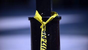 WASHINGTON, DC - AUGUST 17: Yellow police tape is left on a pol