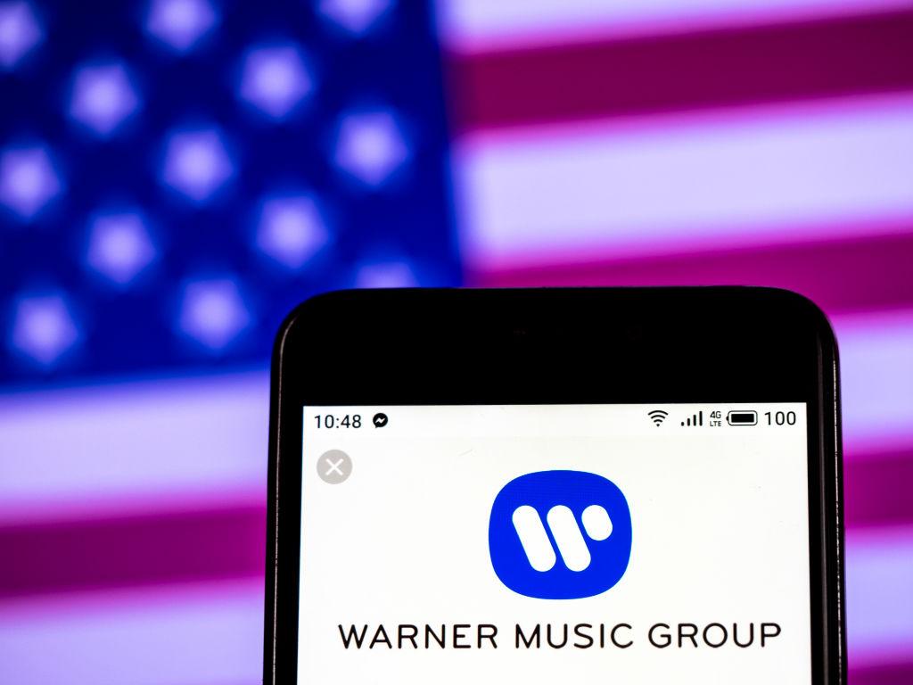 Warner Music Group company logo seen displayed on a smart