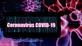 In this photo illustration a Corona Virus (Covid 2019) logo...