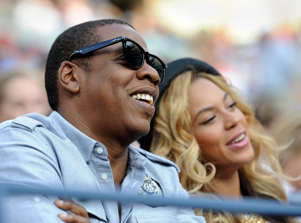 Entertainer Jay-Z (L) and wife Beyonc� (