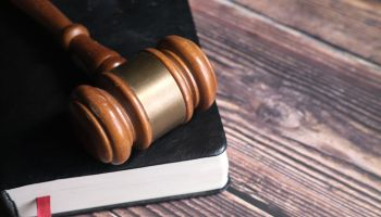 Close Up Of Gavel On A Book On Table.