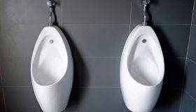 Close up of white urinal toilet blocks in public restroom