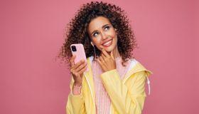 Beautiful woman in raincoat with smart phone